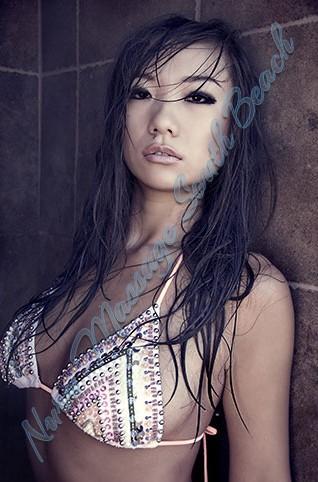 Asian poses in string bikini in the shower