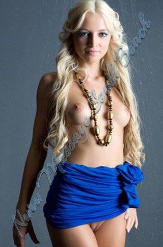Long blonde haired model poses topless