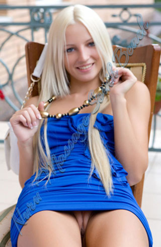 Sexy Blond in a panti-less blue dress
